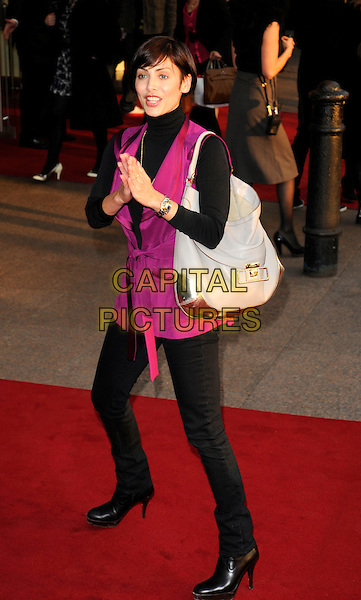 "NATALIE IMBRUGLIA .World premiere of ""What Happens In Vegas"" held at the Odeon Leicester Square, London, England. .April 22nd 2008.full length pink purple wrap jacket necklace black polo neck turtleneck silver bag purse grey gray jeans denim hands together praying .CAP/CAN.©Can Nguyen/Capital Pictures."