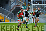 Kevin Gorman Kilcummin breaks away from Padraig Lucey Legion during their SFC clash in Fitzgerald Stadium on Sunday