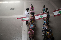 June 08, 2015 - Bekaa Valley, Lebanon: Syrian refugee children form a queue during a break at the evening shift in Qoub Elias elementary school. (Photo/Narciso Contreras)