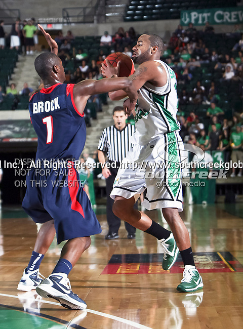 South Alabama Jaguars guard/forward Martino Brock (1) defends North Texas Mean Green guard Shannon Shorter (21) during the NCAA  basketball game between the South Alabama Jaguars and the University of North Texas Mean Green at the North Texas Coliseum,the Super Pit, in Denton, Texas. UNT defeated South Alabama 82 to 79...