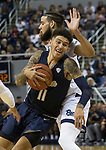 Akron guard Channel Banks (11) is fouled as he drives against Nevada in the second half of an NCAA college basketball game in Reno, Nev., Saturday, Dec. 22, 2018. (AP Photo/Tom R. Smedes)
