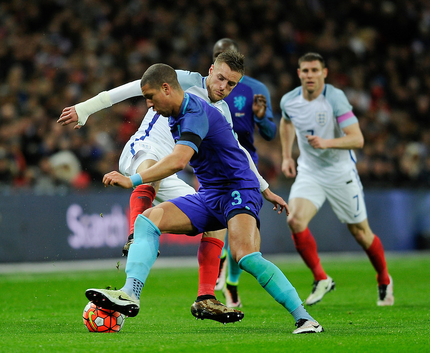 England's Jamie Vardy battles for possession with Holland's Jeffrey Bruma <br /> <br /> Photographer AshleyWestern/CameraSport<br /> <br /> Football - Breast Cancer Care International Friendly - England v Holland - Tuesday 29th March 2016 - Wembley Stadium - London<br /> <br /> &copy; CameraSport - 43 Linden Ave. Countesthorpe. Leicester. England. LE8 5PG - Tel: +44 (0) 116 277 4147 - admin@camerasport.com - www.camerasport.com
