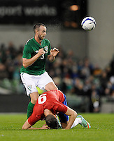 5th March 2014; Marc Wilson, Ireland and Filip Dordevic of Serbia.  International Friendly, Republic of Ireland v Serbia, Aviva Stadium, Dublin. Picture credit: Tommy Grealy / actionshots.ie