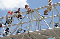 Fans climb RR crossing at Miami Heat NBA 2013 Championship parade, Biscayne Boulevard, American Airlines Arena, Miami, FL, June 24, 2013