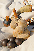Cannon ammunition: grenade-with wooden fuse, langridge-pieces of scrap metal, and grape shot-packed in canvas around wooden dowel, with powder horn, at a Revolutionary War artillery encampment on Bemis Heights, site of a major British defeat in October 1777, Saratoga National Historical Park, Stillwater, New York, USA.