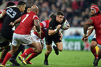 Dan Carter of New Zealand goes on the attack. Rugby World Cup Pool C match between New Zealand and Tonga on October 9, 2015 at St James' Park in Newcastle, England. Photo by: Patrick Khachfe / Onside Images