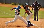 "Major League Baseball prospect Ariel Rodriguez slides in safely during the final game of the ""Torneo Supremo"" at the Quiskeya National Stadium in Santo Domingo. The Tournament which aims to maximize the ability of Major League Baseball organizations to scout in the Dominican Republic. According to the MLB's office in the Dominican Republic, this year, the tournament introduced 23 new baseball prospects. July 29 2011. ViewPress/ Kena Betancur"
