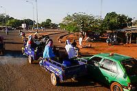 BURKINA FASO , Bobo Dioulasso, street traffic, chinese three-wheeler Apsonic