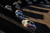 Mar. 1, 2009; Las Vegas, NV, USA; NASCAR Sprint Cup Series driver Kyle Busch (18) leads a pack of cars during the Shelby 427 at Las Vegas Motor Speedway. Mandatory Credit: Mark J. Rebilas-