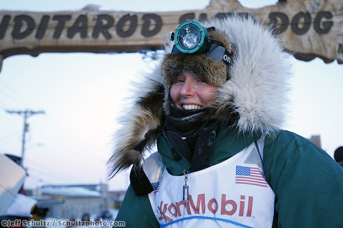 Paige Drobny poses at the finish line after finishing in 34th place on Thursday March 14, 2013. Iditarod Sled Dog Race 2013..Photo by Jeff Schultz copyright 2013 DO NOT REPRODUCE WITHOUT PERMISSION