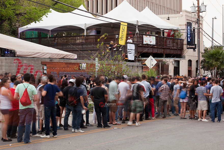 Hour-plus waits to get into Red River District venues at SXSW are common place