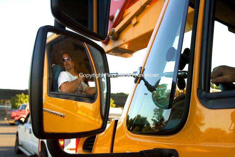 SOUTHBURY, CT - 03 September 2005 -090305JS04--Connecticut Light and Power crew member Gil Garver of CL&P's Newtown System Projects, looks out his mirror as the crews depart Southbury on Saturday enroute to the Mississippi coast to help restore power to those effected by Hurricane Katrina.   --Jim Shannon / Republican-American  -- Gil Garver, Connecticut Light and Power; Southbury Plaza are CQ