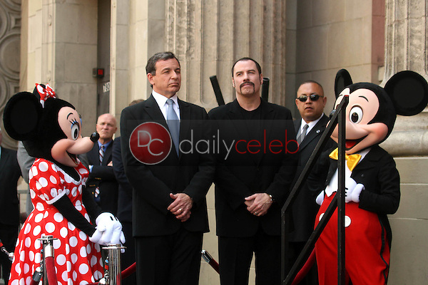 Bob Iger and John Travolta<br />