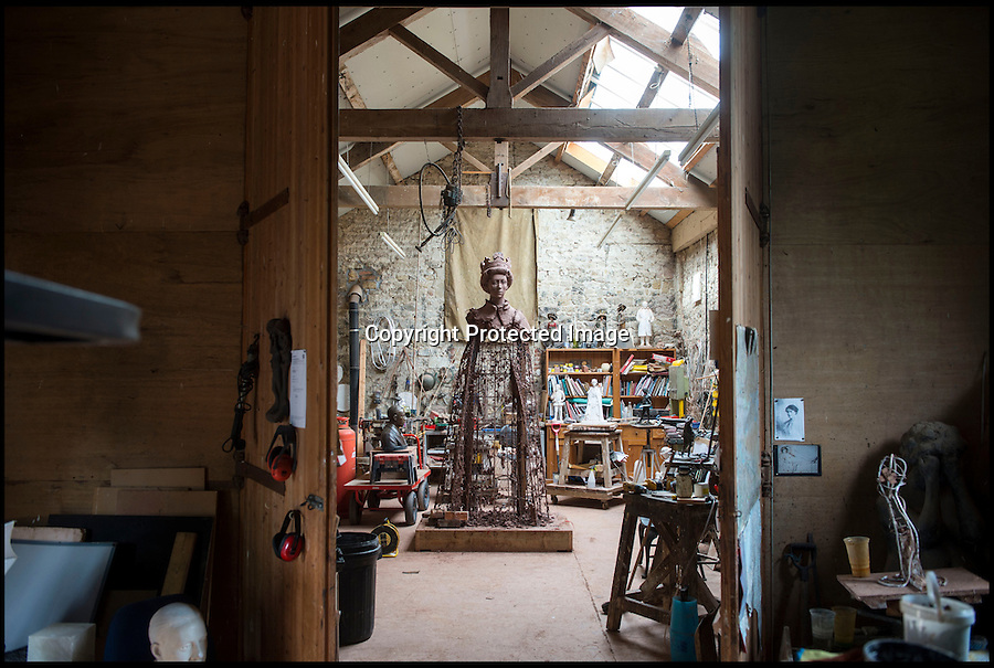 BNPS.co.uk (01202 558833)<br /> Pic: PhilYeomans/BNPS<br /> <br /> Larger than life - James Butler's Oxfordshire studio with the remains of his clay sculpture of the Queen from which the bronze cast was made.<br /> <br /> A huge statue of Queen Elizabeth II is being finished off at Lockbund Foundry near Banbury in Oxfordshire - before its unveiling at Runnymede to celebrate the 800th anniversary of Magna Carta.<br /> <br /> At over twice life size the imposing bronze sculpture by James Butler will dominate the historic meadow where the divine right of Kings was first checked.<br /> <br /> It shows the Queen in full Garter Robes and has been inspired by the 1954 portraits by Pietro Annigoni. The 4m (13ft) bronze sculpture will be unveiled on 14 June.