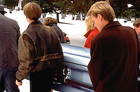 Family carrying grandmas coffin to the grave age 20 and 35.  Minneapolis Minnesota USA