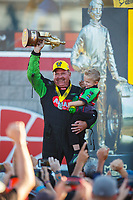 Oct 29, 2017; Las Vegas, NV, USA; NHRA top fuel driver Terry McMillen celebrates with son Cameron McMillen after winning the Toyota National at The Strip at Las Vegas Motor Speedway. Mandatory Credit: Mark J. Rebilas-USA TODAY Sports