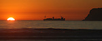 A cargo ship heads out to sea around Point Loma as the sun sets, as seen from Coroando, Ca., on Jan. 18, 2011..Photo by Cathleen Allison