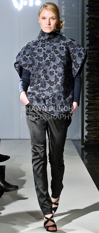 "Model walks the runway in a jacquard print oversized raised collar tunic, round neck knit top, and silk satin stretch pant, during the Blanc de Chine 2010 Fall Winter ""The Elegance of the Ming Design"" collection runway show on March 24, 2010."