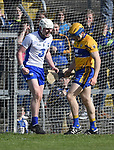 Shane Bennett of Waterford celebrates his team's second goal to the disappointment of Seadna Morey of Clare during their National League game at Cusack Park. Photograph by John Kelly.