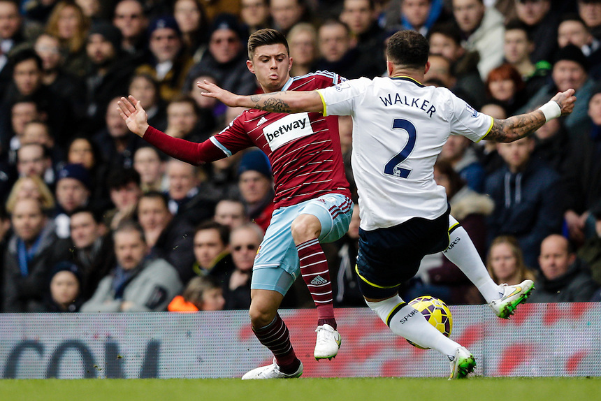 West Ham United's Aaron Cresswell battles for possession with Tottenham Hotspur's Kyle Walker<br /> <br /> Photographer Craig Mercer/CameraSport<br /> <br /> Football - Barclays Premiership - Tottenham Hotspur v West Ham United - Sunday 22nd February 2015 - White Hart Lane - London<br /> <br /> &copy; CameraSport - 43 Linden Ave. Countesthorpe. Leicester. England. LE8 5PG - Tel: +44 (0) 116 277 4147 - admin@camerasport.com - www.camerasport.com