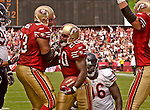 San Francisco 49ers running back Garrison Hearst (20) and tackle Derrick Deese (63) celebrate touchdown on Sunday, September 7, 2003, in San Francisco, California. The 49ers defeated the Bears 47-7.