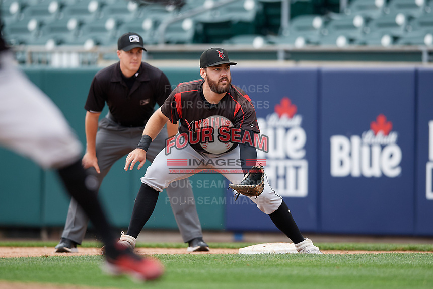 Indianapolis Indians first baseman Will Craig (25) gets into position as umpire Brennan Miller looks on during an International League game against the Buffalo Bisons on June 20, 2019 at Sahlen Field in Buffalo, New York.  Buffalo defeated Indianapolis 11-8  (Mike Janes/Four Seam Images)