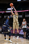 Elisa Penna (41) of the Wake Forest Demon Deacons launches a three-point shot over Arike Ogunbowale (24) of the Notre Dame Fighting Irish during second half action at the LJVM Coliseum on December 31, 2017 in Winston-Salem, North Carolina.  The Fighting Irish defeated the Demon Deacons 96-73.  (Brian Westerholt/Sports On Film)