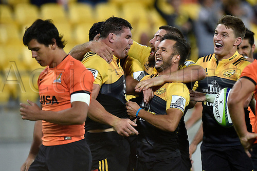 09.04.2016. Wellington, New Zealand.  Ben May (Centre L) of the Hurricanes   celebrates a try with team mates Jamison Gibson-Park (Centre R) and Beauden Barrett (R as Jaguares' Emiliano Boffelli (L) walks pas dejected  during the Hurricanes versus Jaguares Super Rugby match at the Westpac Stadium in Wellington on Saturday 9thApril 2016.