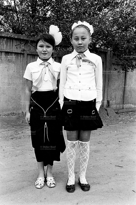 Kazakhstan. Semipalatinsk. Two girlfriends dressed for their 4th grade school graduation. Celebration of the end of the school's year. Semey is the kazak name for Semipalatinsk and is located in the Eastern Kazakhstan Province. © 2008 Didier Ruef .
