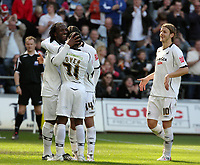 Pictured: (L-R) Jason Scotland of Swansea City celebrates his goal with team mates Nathan Dyer Jordi Gomez and Andrea Orlandi<br /> Re: Coca Cola Championship, Swansea City FC v Norwich City FC at the Liberty Stadium Swansea, south Wales. Saturday 11 April 2009.<br /> Picture by D Legakis Photography / Athena Picture Agency, Swansea 07815441513