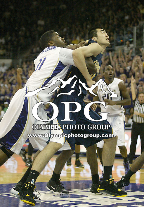16 January 2010:  Washington Huskies forward #11 Matthew Bryan-Amaning battles against California center Max Zhang for position under the basket. Washington won 84-69 over California at the Bank of America Arena in Seattle, WA.