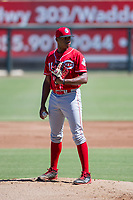 Cincinnati Reds pitcher Hunter Greene (21) looks to his catcher for the sign during an Instructional League game against the Kansas City Royals October 2, 2017 at Surprise Stadium in Surprise, Arizona. (Zachary Lucy/Four Seam Images)