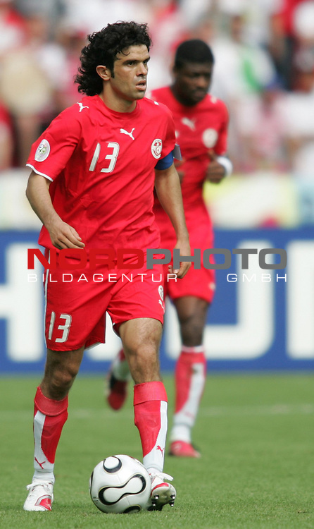 FIFA WM 2006 - Gruppe H ( Group H )<br /> Play #48 (23-Jun) - Ukraine vs Tunisia.<br /> Riadh Bouazizi with ball during the match of the World Cup in Berlin.<br /> Foto &copy; nordphoto