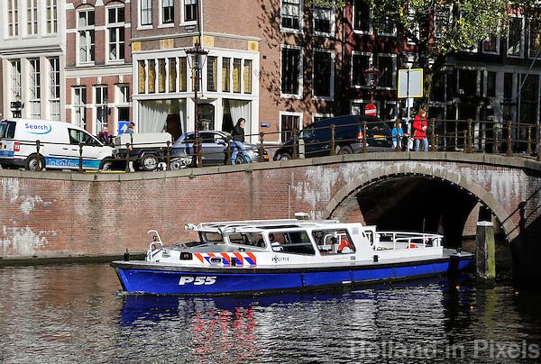 Waterpolitie in de Amsterdamse grachten