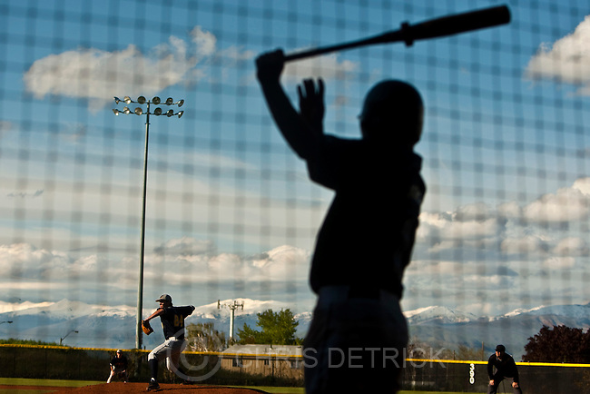 Photo by Chris Detrick | The Salt Lake Tribune .Bonneville's Evan Parker (24) pitches as Westlake's David Morgan (11) warms up during the game at Kearns High School Tuesday May 24, 2011.