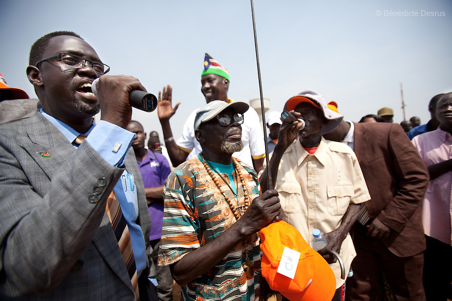 9 december 2010 - Juba, South Sudan - Southern Sudanese citizens march in the streets in support of the independence referendum in Juba, South Sudan. The march ended at the large outdoor mausoleum for Dr John Garang, where it swelled into a rally with political leaders and activists giving speeches. According to South Sudanese officials, more than 2.8 million people have registered to vote in the referendum. The referendum on whether the oil-producing region should declare independence, scheduled for Jan. 9, is the climax of a 2005 peace deal that ended decades of north-south conflict - Africa's longest civil war that was fought over ethnicity, religion, ideology and oil and that killed 2 million people. Photo credit: Benedicte Desrus