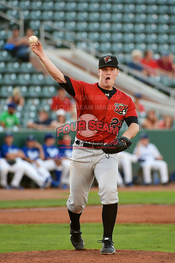 Andrew Mitchell (23) of the Great Falls Voyagers makes a pickoff throw to first base against the Ogden Raptors at Lindquist Field on August 13, 2013 in Ogden Utah. (Stephen Smith/Four Seam Images)