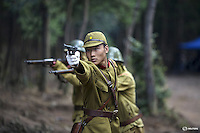 "An actor dressed as a historical Japanese army officer shoots a fake gun on the set of ""The Last Prince"" television series at Hengdian World Studios in Hengdian July 23, 2015. There are eleven productions about the war against Japan being filmed at Hengdian World Studios. The facility itself, located in China's Zheijang province, is the biggest movie lot ever built. Director Li Xiaoqiang said the series is about a Qing Dynasty prince, who joined the Chinese nationalist army after suffering family misfortune. ""After he learnt more about the Communist Party, the prince began to understand what real revolution and the anti-Japanese war meant, and turned to the Communist Party to fight Japan"", the director added. According to local media, more than 10 new movies, 12 TV dramas, 20 documentaries and 183 war-themed stage performances will be released in China to coincide with the 70th anniversary of the end of World War Two. REUTERS/Damir SagoljPICTURE 13 OF 28 FOR WIDER IMAGE STORY ""BEHIND THE SCENES OF A CHINESE WAR DRAMA"".SEARCH ""SAGOLJ STUDIO"" FOR ALL PICTURES."
