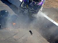 Feb 25, 2018; Chandler, AZ, USA; NHRA funny car driver John Force crashes with Jonnie Lindberg during the Arizona Nationals at Wild Horse Pass Motorsports Park. Mandatory Credit: Mark J. Rebilas-USA TODAY Sports