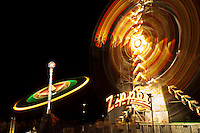 Carnival rides spinning at night (blurred motion) photo in austin, texas
