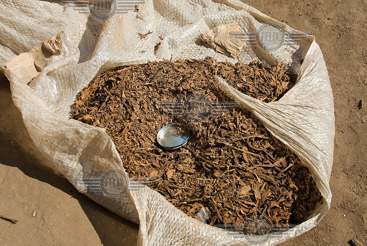 Tobacco is sold at a market in Mbenje.