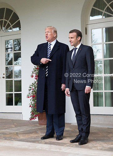United States President Donald J. Trump speaks to the media with President Emmanuel Macron of France before holding a meeting during a state visit to The White House in Washington, DC, April 24, 2018. Credit: Chris Kleponis / Pool via CNP