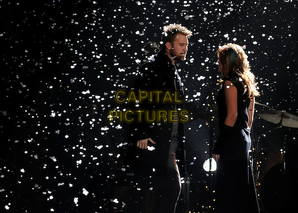 LADY ANTEBELLUM - CHARLES KELLEY & HILLARY SCOTT .performs during the 43rd Annual CMA Awards, Country Music's Biggest Night, held at the Sommet Center, Nashville, Tennessee, USA, 11th November 2009. live show on stage half length concert gig music black side profile snow .CAP/ADM/LF.©Laura Farr/AdMedia/Capital Pictures.