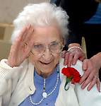Helen Morlock, age 102, poses with a corsage she received during the visit of 3rd grade students of Chestnut Hill Elementary School in Melville who were at the Huntington Hills Center for Health and Rehabilitation in Melville on Friday May 11, 2007, to deliver Mother's Day corsages to senior  patients at the Center. The event was sponsored by Genser Dubow Genser & Cona law firm and Half Hollow Flowers & Gifts. (Morlock signed a release which is filed in the Photo Dept) Photo by Jim Peppler.