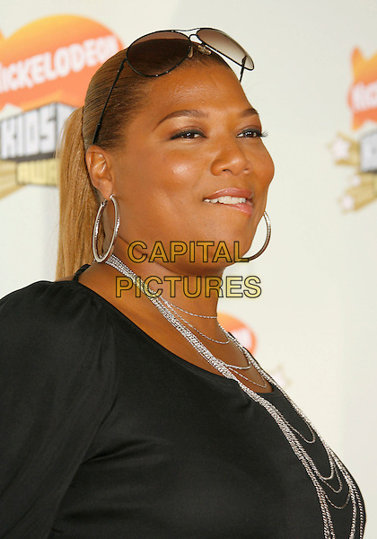 QUEEN LATIFAH.20th Annual Nickelodeon Kids' Choice Awards held at UCLA's Pauley Pavilion, Westwood, California, USA,.31 March 2007..portrait headshot suglasses on head funny biting lip.CAP/ADM/RE.©Russ Elliot/AdMedia/Capital Pictures.