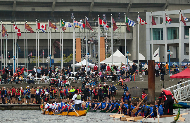 Vancouver, Canada, Aug 8th 2009. World Police and Fire Games, Dragon Boat Competition.  Competitors paddle their boats back to the dock after racing in the Men's Open 20.  The races were held at the Plaza of Nations in Vancouver.  Photo by Gus Curtis