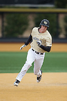 Kevin Conway (7) of the Wake Forest Demon Deacons hustles towards third base against the Harvard Crimson at David F. Couch Ballpark on March 5, 2016 in Winston-Salem, North Carolina.  The Crimson defeated the Demon Deacons 6-3.  (Brian Westerholt/Four Seam Images)