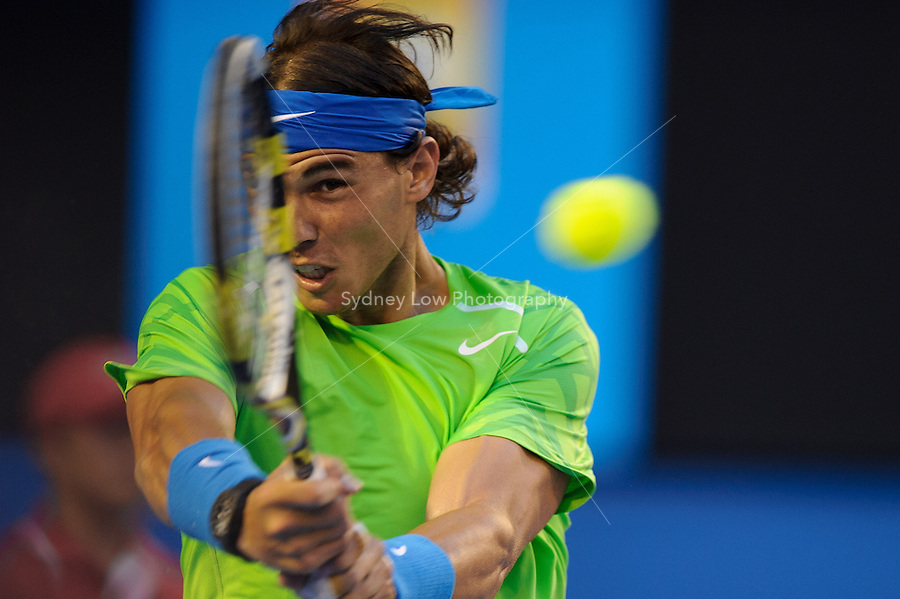 MELBOURNE, 24 JANUARY - Rafael Nadal (ESP) in action against Tomas Berdych (CZE) during a men's quarterfinals match on day nine of the 2012 Australian Open at Melbourne Park, Australia. (Photo Sydney Low / syd-low.com)