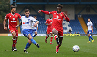 Bury's Chris Maguire crosses the ball despite the attentions of Milton Keynes Dons' Gboly Ariyibi<br /> <br /> <br /> Photographer Juel Miah/CameraSport<br /> <br /> The EFL Sky Bet League One - Bury v Milton Keynes Dons - Saturday 30th September 2017 - Gigg Lane - Bury<br /> <br /> World Copyright &copy; 2017 CameraSport. All rights reserved. 43 Linden Ave. Countesthorpe. Leicester. England. LE8 5PG - Tel: +44 (0) 116 277 4147 - admin@camerasport.com - www.camerasport.com