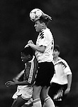 A Sprayberry High School defender heads the ball over a Lassiter High School forward in a 1996 battle of county rivals in Marietta, Ga.